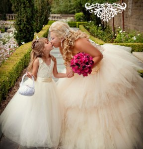 Hollywood BrideTakes A Moment With Her Flower Girl