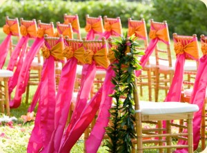 Spice up your wedding day with Chivari Chairs and Hot Pink and Orange Sashes
